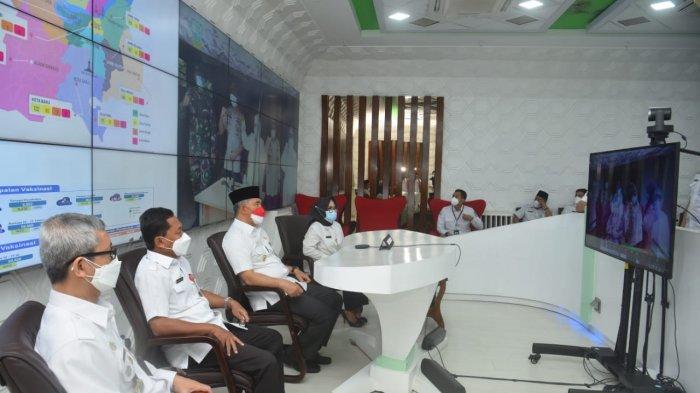 Wali Kota Fasha secara simbolis meluncurkan empat inovasi dan aplikasi percepatan penanganan Covid-19 di Kota Jambi.