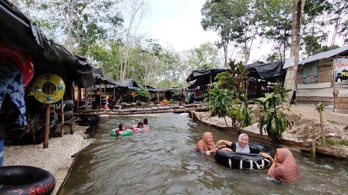 Wisata kali batu putih di Desa Pasar Singkut, Kecamatan Singkut, Kabupaten Sarolangun semakin populer di kalangan wisatawan.