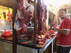 aktivitas-pedagang-daging-sapi-di-pasar-yang-ada-di-kota-jambi.jpg