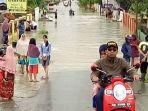 banjir-akibat-hujan-deras-dan-angin-kencang-di-kerinci.jpg