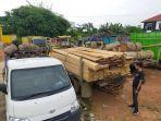 dua-truk-bermuatan-kayu-diduga-illegal-logging-diamankan-polres-batanghari.jpg