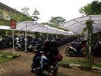 fasilitas-parkir-berbayar-di-universitas-jambi_20180403_133921.jpg