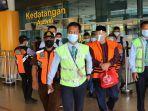 ketiga-terdakwa-tahanan-kpk-tiba-di-bandara-sulthan-thaha-jambi-senin-122021.jpg