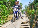 kondisi-jembatan-gantung-di-desa-lubuk-bumbun-kecamatan-margo-tabir-merangin-memprihatinkan.jpg