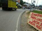 kondisi-jembatan-sungai-belati-di-kabupaten-merangin-membuat-pengguna-jalan-kerepotan-rabu-158_20180815_132659.jpg
