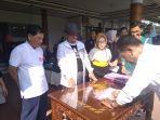 launching-program-jambi-bugar-wawako-maulana-bagikan-10167-kartu-bpjs.jpg