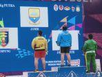 m-ripqi-ramadhan-atlet-angkat-besi-dari-jambi-menambah-perolehan-medali-emas-dalam-pon-xx-papua.jpg