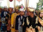 nikah-massal-di-festival-kerinci-2019-diikuti-15-pasangan-pengantin-baralek-basamo-kurang-diminati.jpg