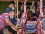 pedagang-daging-di-pasar-jambi.jpg