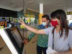 penumpang-sedang-melakukan-registrasi-keberangkatan-bandara-sultan-thaha.jpg