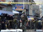 polisi-dan-tentara-mengamankan-lokasi-ledakan-di-sebuah-gereja-di-pulau-jolo.jpg