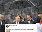 presiden-rusia-vladimir-putin-saat-berada-di-podium-bersama-pemimpin-dunia-lainnya_20180716_174736.jpg