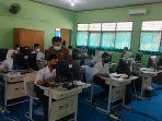siswa-sman-5-muarojambi-ikuti-asesmen-nasional-berbasis-komputer.jpg