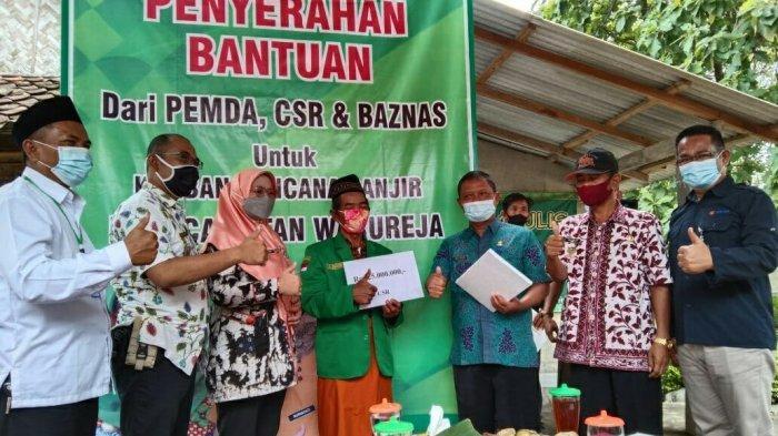 Pemkab Tegal Salurkan Bantuan Perbaikan Rumah Akibat Banjir Bagi Warga di Warureja
