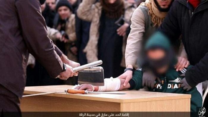 ISIS Merilis Foto-foto Sadis Potong Tangan Pencuri di Raqqa - isis-merilis-foto-foto-sadis-potong-tangan-pencuri-di-raqqa_20160212_203408.jpg
