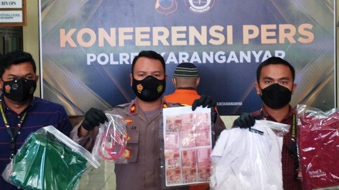 Wakapolres Karanganyar, Kompol Purbo Adjar Waskito menunjukan barang bukti kasus penipuan berkedok sebagai dokter saat konferensi pers di Kantor Satreskrim Polres Karanganyar, Kamis (15/7/2021).