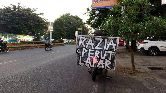 Pemuda Pati Kritik Kebijakan PPKM melalui Aksi Razia Perut Lapar