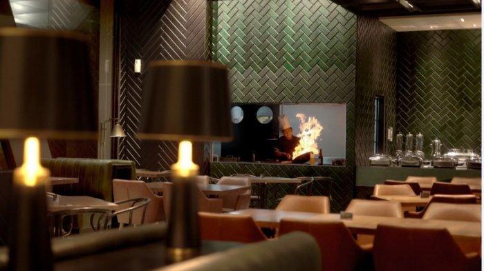 Tampak restoran yang ditawarkan kepada tamu hotel oleh Awann Sewu Boutique Hotel & Suite.