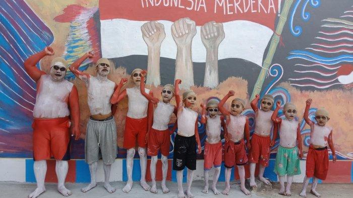 Semarak Hari Kemerdekaan HUT ke-74 RI, Warga Petodanan Batang Kompak Cat Rumah Merah Putih