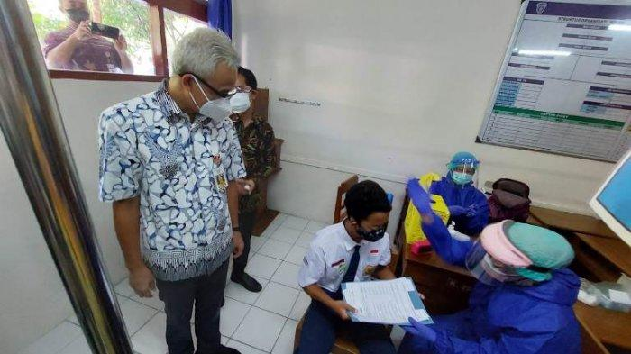 Vaksinasi Pelajar di Kota Solo, Meski Sakit Irfan Berharap Segera Bisa Kembali Sekolah Tatap Muka
