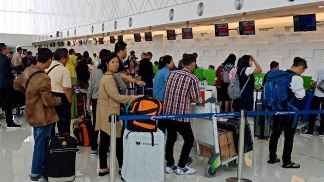 sejumlah-tki-tiba-di-bandara-internasional-ahmad-yani-semarang_20180612_154759.jpg