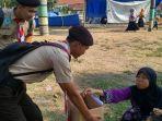 anggota-pramuka-kwarran-slawi-menggalang-dana-untuk-korban-gempa-dan-tsunami-di-sulteng_20181030_164306.jpg