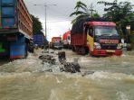 banjir-menggenangi-jalan-pantura-kendal-minggu-722021.jpg
