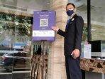 barcode-aplikasi-pedulilindungi-di-pintu-masuk-hotel.jpg