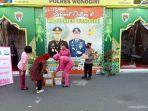 bhayangkari-polres-wonogiri-membagikan-takjil-di-pos-pengamanan-pasar-kota-wonogiri.jpg