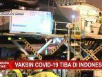 boks-yang-berisi-vaksin-covid-19-diturunkan-dari-pesawat-garuda-indonesia.jpg