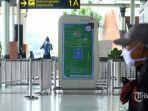 calon-penumpang-menunggu-jadwal-penerbangan-di-terminal-1-bandara-soekarno-hatta.jpg