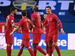cristiano-ronaldo-kanan-merayakan-gol-pembuka-gol-ke-100nya-untuk-portugal.jpg
