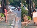 dinar-candy-ditangkap-polisi-seusai-pakai-bikini-di-trotoar-bawa-spanduk-stres-ppkm.jpg