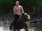 foto-hoax-putin-menunggang-beruang_20170101_163344.jpg