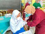 foto-siswa-mtsn-2-tegti-vaksinasi-covid-21.jpg