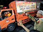 ganjar-lepas-truk-bantuan-korban-banjir-jakarta.jpg