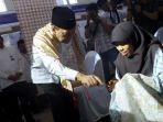 gubernur-bank-indonesia-agus-martowardjojo-membuka-festival-syariah_20180502_151025.jpg