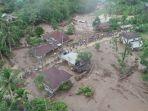 hujan-lebat-sejak-kamis-menimbulkan-banjir-besar-di-sumatera-barat_20181012_211815.jpg