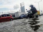 jalan-raya-kaligawe-langganan-banjir-rob_20180208_201122.jpg