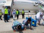 jamaah-haji-kloter-1-tiba-di-bandara-adi-soemarmo-boyolali-selasa-2882018_20180828_161114.jpg