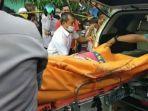 jasad-siti-amidah-25-dievakuasi-petugas-kepolisian-setelah-ditemukan-tewas-terkubur.jpg