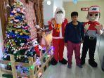 jne-semarakan-natal-2018-dengan-berbagi-kebahagiaan-kepada-pelanggan-di-11-kota.jpg