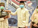 ketua-pp-masjid-agung-jawa-tengah-noor-achmad-danketua-pima-jt-sembako.jpg