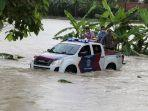 mobil-patroli-polres-kebumen-saat-menerobos-banjir.jpg