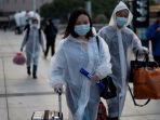orang-orang-mengenakan-masker-sampai-di-stasiun-kereta-hankou-wuhan.jpg