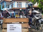 para-pengemudi-sepeda-motor-menjadikan-lahan-parkir-di-pasar-langon-kota-tegal.jpg