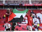 paul-pogba-dan-amad-dialo-kibarkan-bendera-palestina-setelah-duel-manchester-united-vs-fulham1.jpg