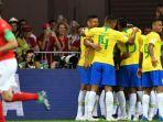 pemain-brasil-melakukan-selebrasi-setelah-philippe-coutinho-mencetak-gol-ke-gawang-swiss_20180618_071635.jpg