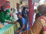 pemeriksaan-swab-test-warga-di-kecamatan-sambirejo-kabupaten.jpg