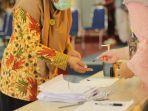 pemungutan-suara-untuk-guru-dan-staff-dalam-pemilihan-kesehatan.jpg